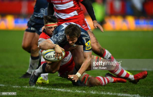 Alan MacGinty of Sale Sharks dives over to score his sides first try during the Aviva Premiership match between Gloucester Rugby and Sale Sharks...