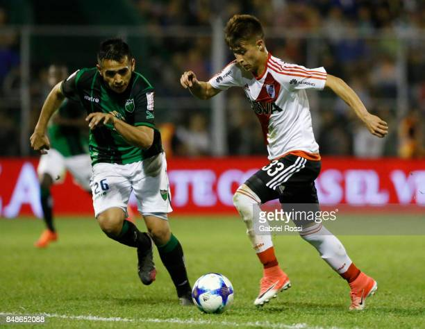 Alan Marcel of River Plate fights for the ball with Adrian Pucheta of San Martin during a match between San Martin de San Juan and River Plate as...