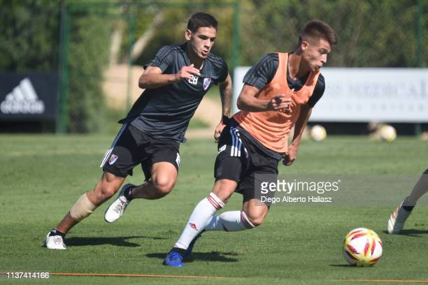 Alan Marcel Picazzo and Lucas Martinez Quarta of River Plate compete for the ball during a training session at River Camp Ezeiza on March 21 2019 in...