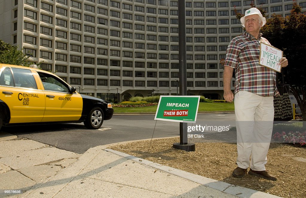 Alan McConnell, of Silver Spring, Md., sells 'Impeach Him' buttons outside of the Hilton Towers Hotel on Connecticut Ave., on Monday morning, June 18, 2007. The 2007 Take Back America Conference, a gathering of progressive political groups organized by the Campaign for America's Future, kicked off its 3-day run at the hotel on Monday.