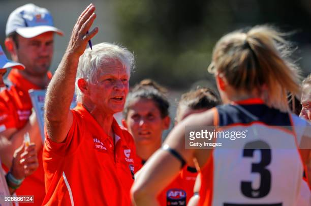 Alan McConnell Senior Coach of the Giants gestures as he talks to the players during the 3 quarter time break during the round five AFLW match...