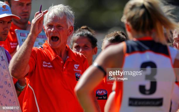 Alan McConnell Senior Coach of the Giants gives orders to the players during 3 quarter time during the round five AFLW match between the Fremantle...