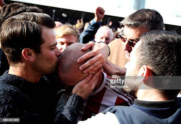 Alan McCormack of Brentford celebrates with fans after winning promotion during the Sky Bet League One match between Brentford and Preston North End...