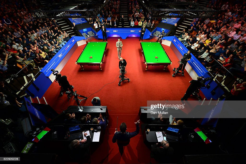 Alan McManus of Scotland makes his way into the arena for his second round match against Ali Carter of England on day six of the World Snooker Championship at The Crucible Theatre on April 21, 2016 in Sheffield, England.