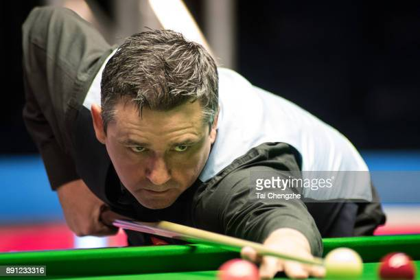 Alan McManus of Scotland plays a shot during his first round match against Matthew Selt of England on day two of the 2017 Scottish Open at Emirates...