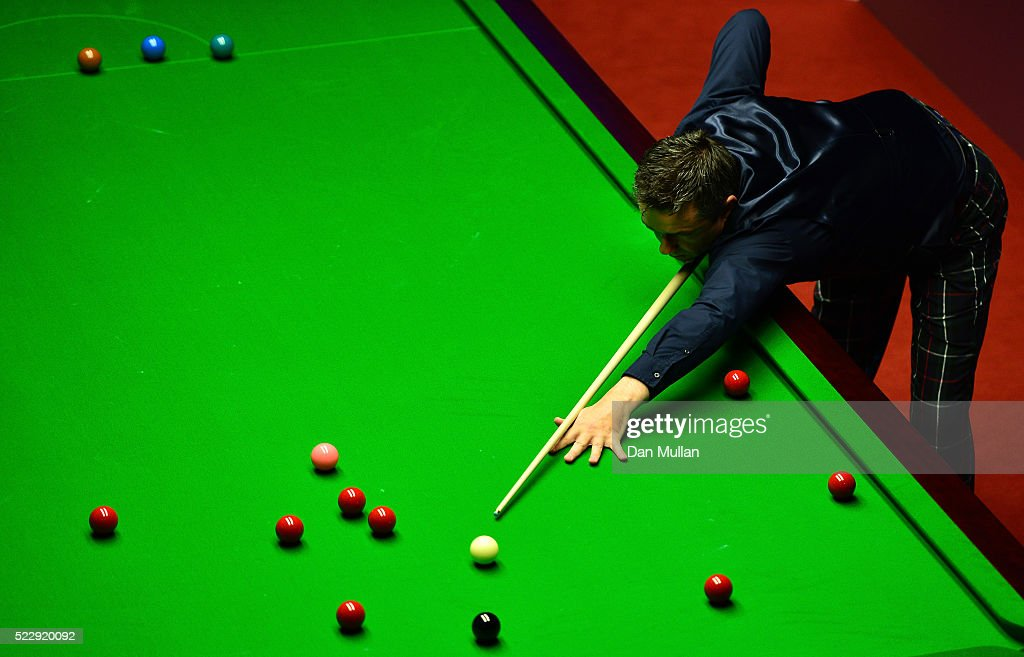 Alan McManus of Scotland plays a shot during his second round match against Ali Carter of England on day six of the World Snooker Championship at The Crucible Theatre on April 21, 2016 in Sheffield, England.