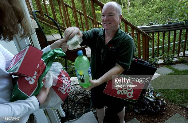 JULY 19 2004 Alan McWilliams makes a delivery to a home in Ashland MA Alan McWilliams works a night shift delivering pizza for Papa Gino's in Ashland...