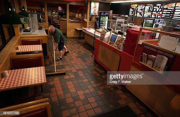JULY 19 2004 Alan McWilliams sweeps the floors at the end of his shift Alan McWilliams works a night shift delivering pizza for Papa Gino's in...