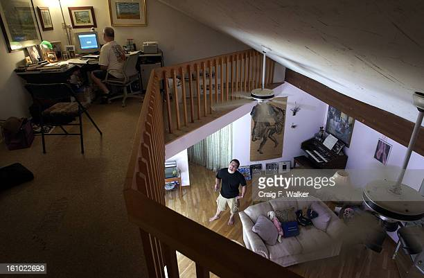 JULY 19 2004 Alan McWilliams uses the internet to research jobs in his home office as his son Erik asks a question Alan and his family have lived in...
