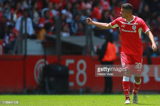 Alan Medina of Toluca celebrates after scoring the fifth goal of his team during the 13th round match between Toluca and Monterrey as part of the...