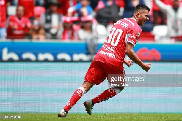 Alan Medina of Toluca celebrates after scoring the first goal of his team during the 11th round match between Toluca and Atlas as part of the Torneo...