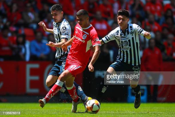 Alan Medina of Toluca struggles for the ball with Jonathan Gonzalez and Johan Vasquez of Monterrey during the 13th round match between Toluca and...