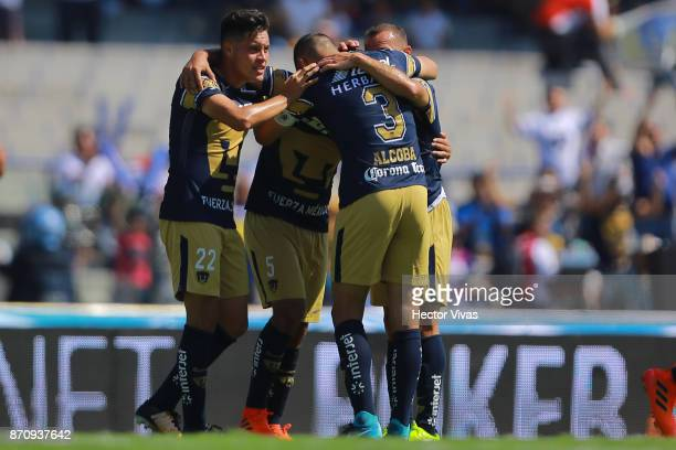 Alan Mendoza of Pumas celebrates with teammates after scoring the first goal of his team during the 16th round match between Pumas UNAM and Santos...