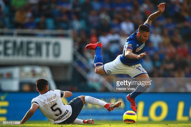 Alan Mendoza of Pumas struggles for the ball with Edgar Mendez of Cruz Azul during the 12th round match between Cruz Azul and Pumas UNAM as part of...
