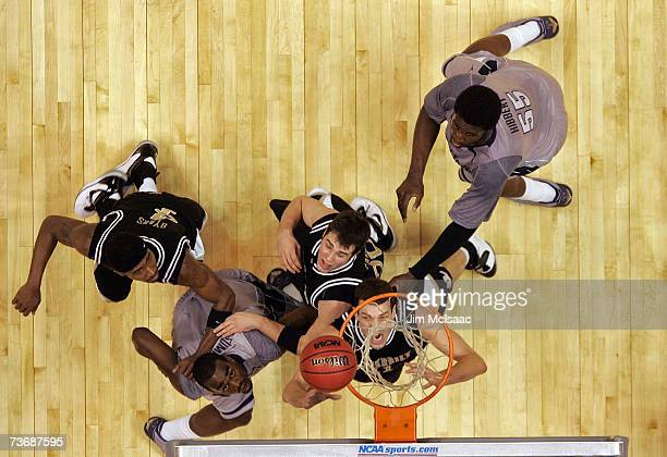 Alan Metcalfe of the Vanderbilt Commodores fights for a rebound against Dajuan Summers of the Georgetown Hoyas during the NCAA Men's East Regional...