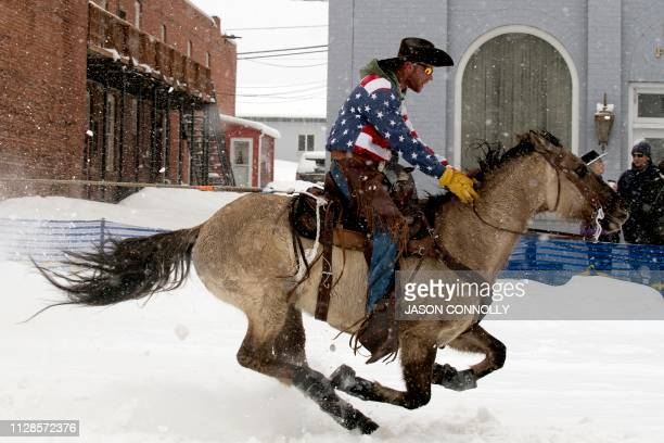 TOPSHOT Alan Mikkelson races down Harrison Avenue during the 71st annual Leadville Ski Joring weekend competition under the snow on March 3 2019 in...