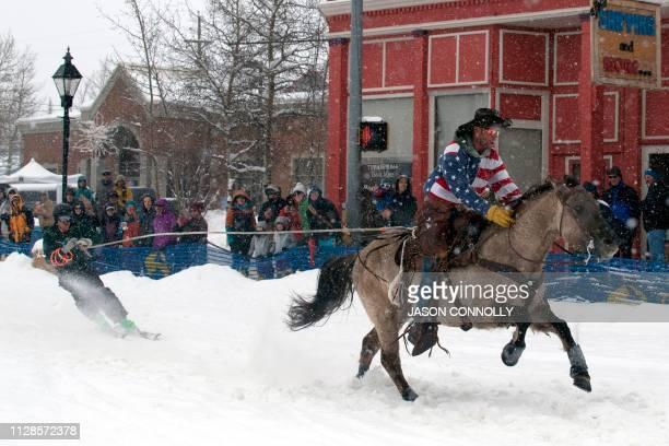 Alan Mikkelson races down Harrison Avenue while skier Greg Dahl navigates the Leadville ski joring course during the 71st annual Leadville Ski Joring...