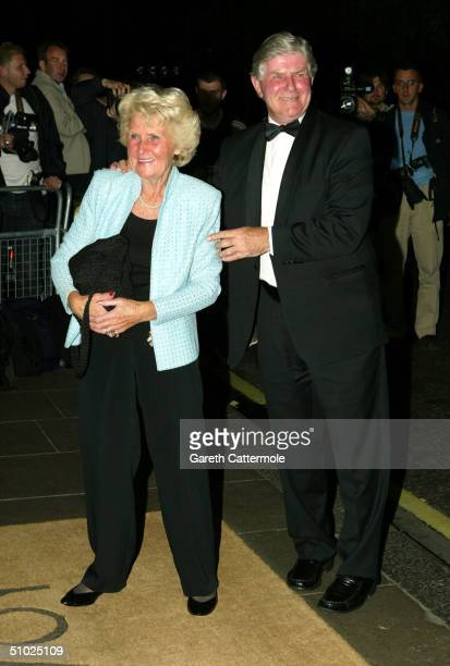 "Alan Mills and his wife arrive at the ""Wimbledon Champion's Dinner"" at The Savoy on July 4, 2004 in London. The annual dinner is organised by the All..."