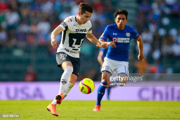 Alan Mozo of Pumas fights for the ball with Angel Mena of Cruz Azul during the 12th round match between Cruz Azul and Pumas UNAM as part of the...