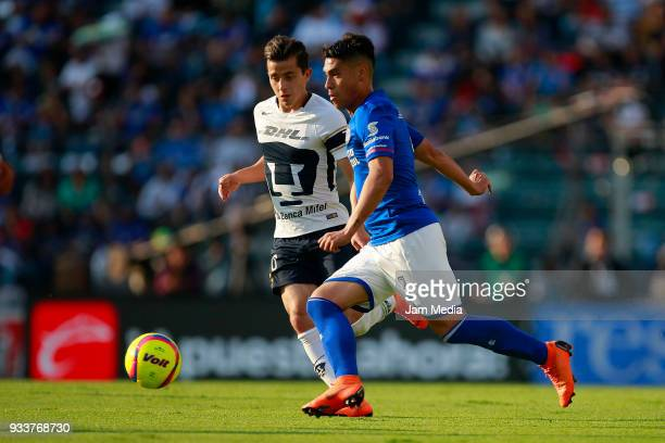 Alan Mozo of Pumas fights for the ball with Felipe Mora of Cruz Azul during the 12th round match between Cruz Azul and Pumas UNAM as part of the...