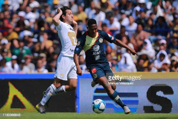 Alan Mozo of Pumas struggles for the ball against Andres Ibargüen of America during the seventh round match between Pumas UNAM and America as part of...