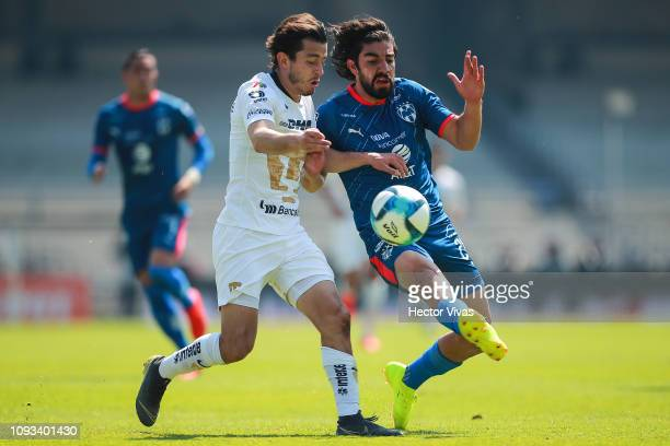 Alan Mozo of Pumas struggles for the ball with Rodolfo Pizarro of Monterrey during the fifth round match between Pumas UNAM and Monterrey as part of...