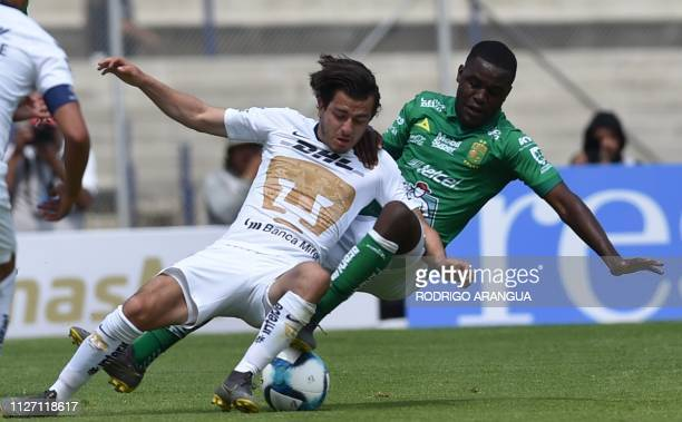 Alan Mozo of Pumas vies for the ball with Joel Campbell of Leon during their Mexican Clausura football tournament match at the Olimpics University...