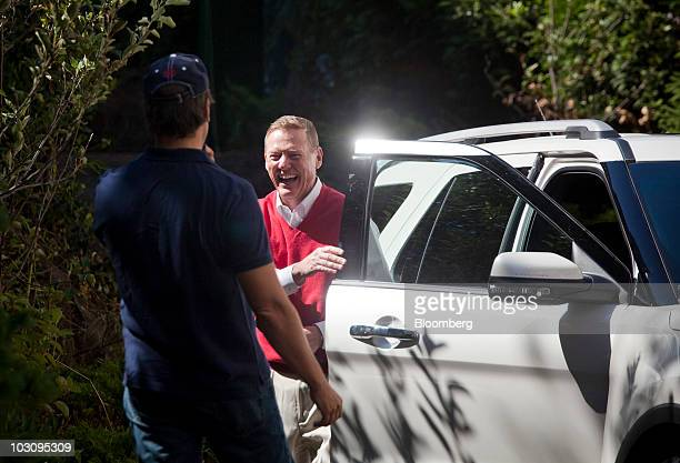Alan Mulally chief executive officer of Ford Motor Co center and Mike Rowe host of Discovery Channel's 'Dirty Jobs' and spokesman for Ford unveil the...