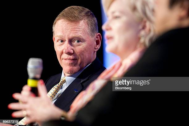 Alan Mulally chief executive officer of Ford Motor Co listens to Deborah WinceSmith president of the Council on Competitiveness speak at a session on...