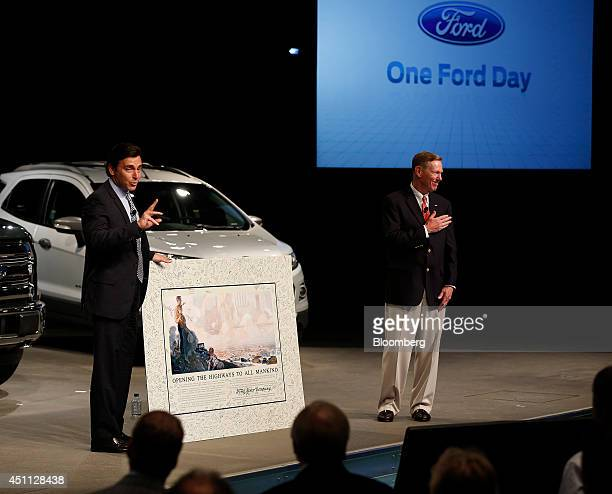 Alan Mulally outgoing chief executive officer of Ford Motor Co right reacts as Mark Fields chief operating officer and incoming chief executive...