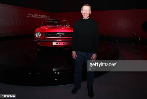 Alan Mulally president and chief executive officer of Ford Motor Company poses for a photo next to a 1965 Ford Mustang Convertible car at the 50...