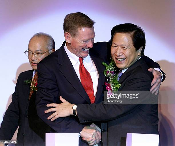 Alan Mulally president and chief executive officer of Ford Motor Co gets a hug from Liang Baohua governor of Jiangsu province at the inauguration of...