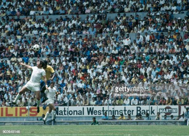 Alan Mullery of England heads the ball away under pressure during the FIFA World Cup match between Brazil and England at the Jalisco Stadium in...