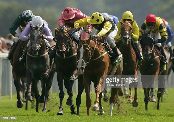 Alan Munro and Sergeant Cecil start there run for home to land The Tote Ebor Race run at York Racecourse on August 17, 2005 in York, England.