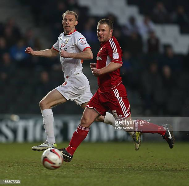 Alan Navarro of Swindon Town looks for the ball with Luke Chadwick of MK Dons during the npower League One match between MK Dons and Swindon Town at...