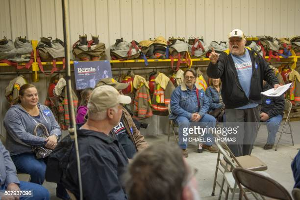 Alan Nelson a Bernie Sanders caucus chairperson speaks to undecided voters at a Democratic Party Caucus at Jackson Township Fire Station on February...