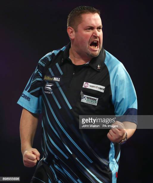 Alan Norris celebrates during his match against James Richardson during day eleven of the William Hill World Darts Championship at Alexandra Palace...