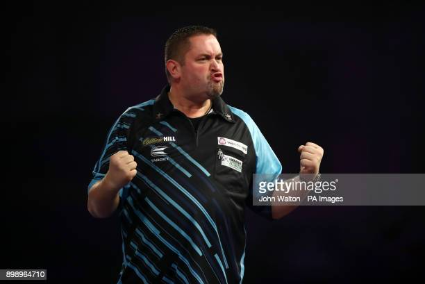 Alan Norris celebrates winning a attritional leg during his match against James Richardson during day eleven of the William Hill World Darts...