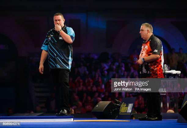 Alan Norris looks dejected during his match against James Richardson on day eleven of the William Hill World Darts Championship at Alexandra Palace...