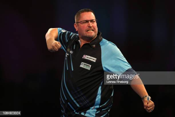 Alan Norris of England celebrates after a throw during his second round match against Steve Lennon of Republic of Ireland during Day Eight of the...