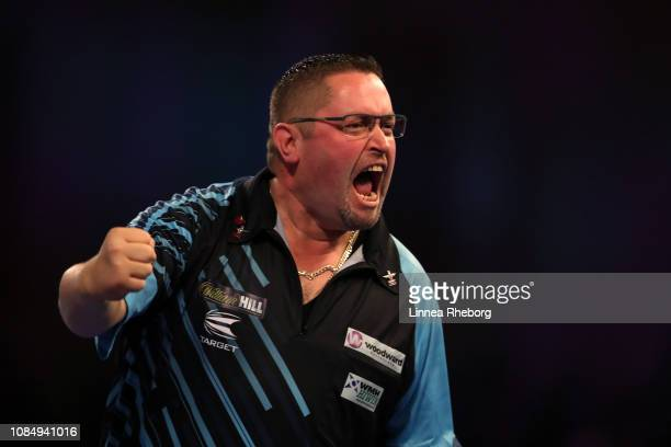 Alan Norris of England celebrates after winning his second round match against Steve Lennon of Republic of Ireland during Day Eight of the 2019...