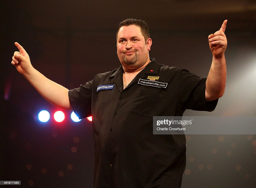 Alan Norris of England celebrates winning a set during his semi-final match against Jan Dekker of Holland during the BDO Lakeside World Professional Darts Championships at Lakeside Complex on January 11, 2014 in Frimley, England.