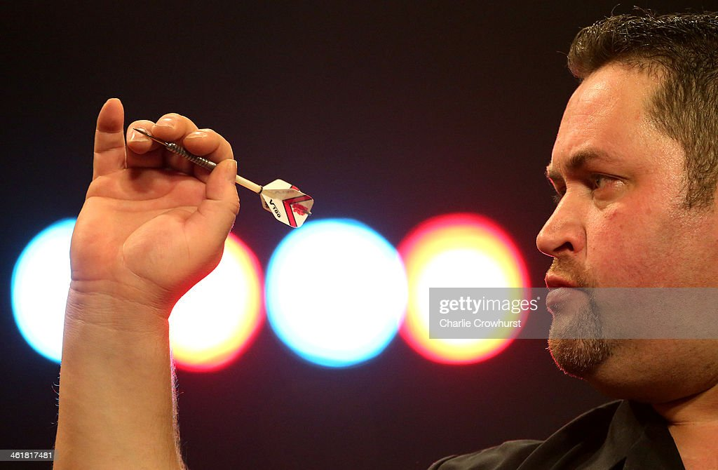 Alan Norris of England in action during his semi-final match against Jan Dekker of Holland during the BDO Lakeside World Professional Darts Championships at Lakeside Complex on January 11, 2014 in Frimley, England.