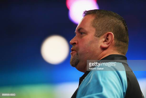 Alan Norris of Scotland looks on during his second round match against James Richardson of England on day eleven of the 2018 William Hill PDC World...