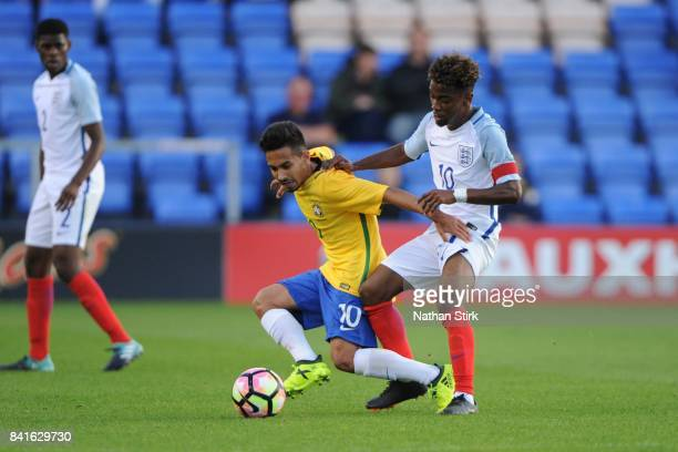 Alan of Brazil and Angel Gomes of England in action during the international friendly match between England U18 and Brazil U18 on September 1 2017 in...