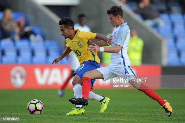 Alan of Brazil and George McEachran of England battle for the ball during the international friendly match between England U18 and Brazil U18 on...