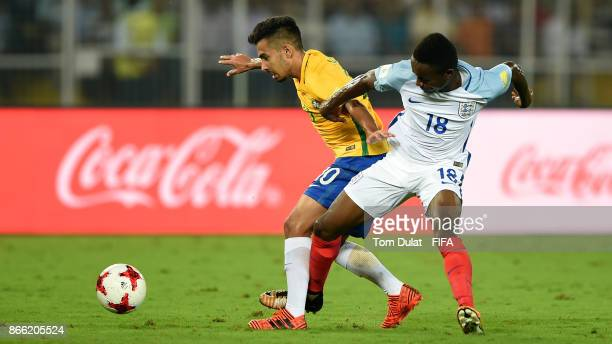 Alan of Brazil and Steven Sessegnon of England in action during the FIFA U17 World Cup India 2017 Semi Final match between Brazil and England at...