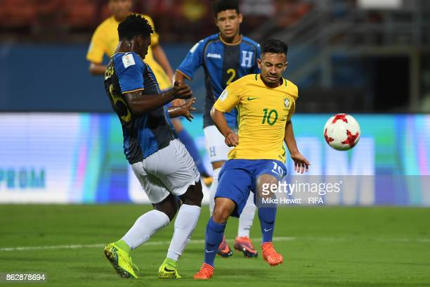 Alan of Brazil is challenged by Cristian Moreira of Honduras during the FIFA U17 World Cup India 2017 Round of 16 match between Brazil and Honduras...