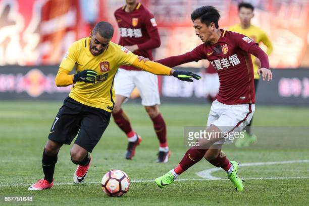 Alan of Guangzhou Evergrande and Ding Haifeng of Hebei China Fortune compete for ball during the Chinese Super League match between Hebei China...