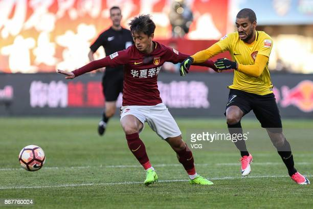 Alan of Guangzhou Evergrande and Ding Haifeng of Hebei China Fortune compete for the ball during the Chinese Super League match between Hebei China...